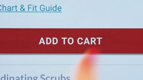 Finger touching add to cart button on a tablet screen stock video footage