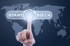 Finger touching button start to 2014 Stock Images