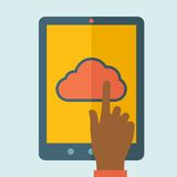 Finger touching cloud. A finger touching cloud on a tablet touch screen. Cloud computing concept. A Contemporary style with pastel palette, soft blue tinted Royalty Free Stock Photos