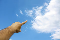 Finger touching clouds Stock Image