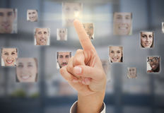 Finger touching futuristic interface Royalty Free Stock Photography