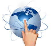 Finger touching globe Royalty Free Stock Photography