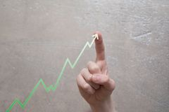 Finger touching green graph arrow royalty free stock images