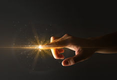 Finger touching interface. Female finger touching a beam of light Stock Images