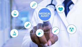 Finger touching medical audit button on screen with symbol network stock photos