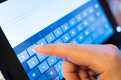 Finger touching screen stock photo