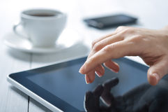 Finger touching screen on tablet-pc Royalty Free Stock Photo