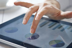 Finger touching screen on tablet-pc Royalty Free Stock Photos