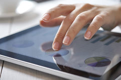 Finger touching screen on touchpad Stock Photos