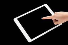 Finger touching tablet pc device Stock Photography