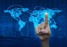Finger touching on the touch screen with world map and city back Royalty Free Stock Photos