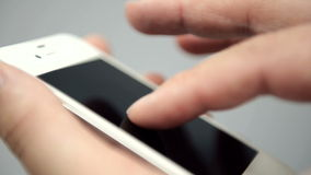 Finger touching touchscreen of smartphone. Finger touching touchscreen of white smartphone stock video footage
