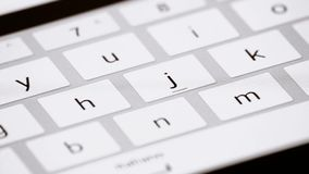 Finger touching virtual keys form a digital keyboard of a touchscreen iPad tablet stock video