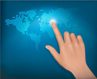 Finger touching world map on a touch screen. Royalty Free Stock Photos