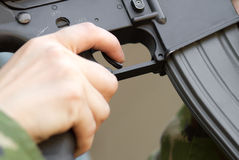 Finger on a trigger Stock Photography