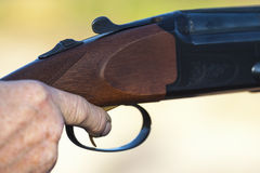 Finger on the trigger. Of a shotgun Stock Photography