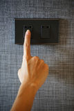 A finger is turning a light switch. Finger is turning a light switch Royalty Free Stock Photography