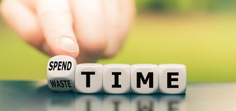 Free Finger Turns A Dice And Changes The Expression `waste Time` To `spend Time. Royalty Free Stock Image - 163746076