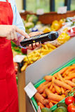 Finger typing on mobile data registration terminal. In a supermarket royalty free stock images
