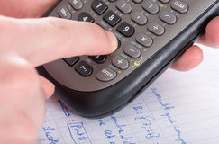 Finger typing on a scientific calculator Royalty Free Stock Image