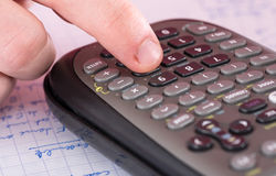 Finger typing on a scientific calculator Royalty Free Stock Images