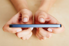 Finger typing on a smartphone Stock Images