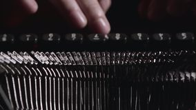 Finger typing on vintage typewriter. Fingers on the keys typing on an old typewriter, in a spacious room on the table is a typewriter stock footage