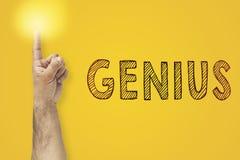 Finger up gesture. Lighting finger next to inscription Genius.  stock image