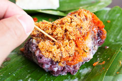 Finger using toothpick stab at sticky rice with Mi. Nced fish ,Dessert food Stock Photos