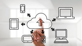 Finger using a touchscreen interface for cloud computing operations Stock Photo