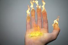 Finger von Kerzen Stockfotografie