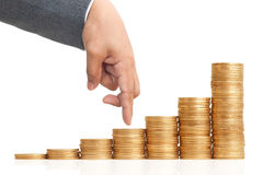 Finger walking on heap of coins Royalty Free Stock Photos