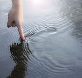 Finger and water Royalty Free Stock Photo