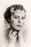 Finger waves hair closeup. Closeup in vintage colors of a 1920s style young woman with diamond headdress and flapper dress stock photo