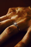 Finger With Wedding Ring Stock Photos