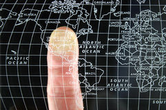 Finger on world Map Stock Photos