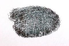 Fingerabdruck auf Weißbuch Stockfotografie