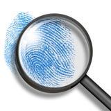 Fingerabdruck durch Vergrößerungsglas Stockbilder