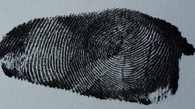 Fingeravtryck på vitbok arkivfilmer