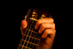 Fingerboard acoustic guitar with finger Stock Photography