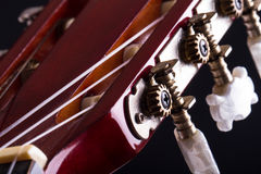 Fingerboard of Classic Guitar. Close up view of fingerboard on classic guitar over black background Stock Photography