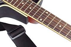 Fingerboard d'isolement de guitare et une courroie image libre de droits