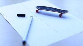 Fingerboard. A fingerboard on a drawn road Royalty Free Stock Photo