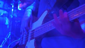 Electro guitar playing closeup. Performer, player, vocalist, instrumentalist playing guitar at concert. Masterclass for. Fingerboard of electric guitar with