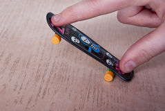 Fingerboard. Fingers riding on small skateboard. No physical activity concept Royalty Free Stock Photos
