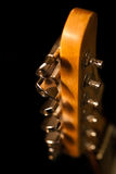 Fingerboard guitar. On a black background in dark colors royalty free stock photos
