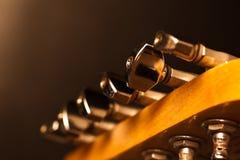 Fingerboard guitar closeup. Fingerboard guitar on a black background in dark colors Stock Images