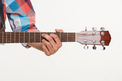 Fingerboard of guitar and hand playing guitar. Royalty Free Stock Photography