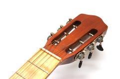 Fingerboard of old guitar on white. Fingerboard of old Spanish guitar on white Royalty Free Stock Image