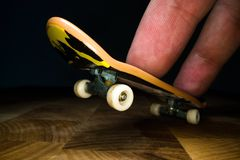 Fingerboard. A small skateboard for kids and teenagers to play with hand fingers. Youth culture, extreme sport.  stock images